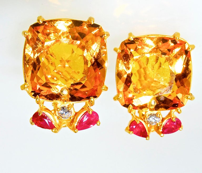 Retro 18K earrings centering fine bright and vivid old cut, Citrine stones - well matched and very clean.  They weigh approximately 10 cts., each.   Accenting these stones are pear cut rubies weighing approximately .50 cts., and a round brilliant