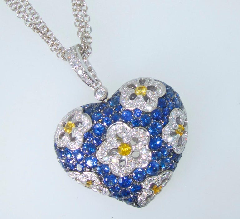 Sapphire and diamond large heart motif pendant necklace with pave set fine natural blue sapphires weighing approximately 5.5 cts., and yellow sapphires weighing approximately .5 cts.  The fine white diamonds (G/H, VS) weigh approximately 2.25 cts.