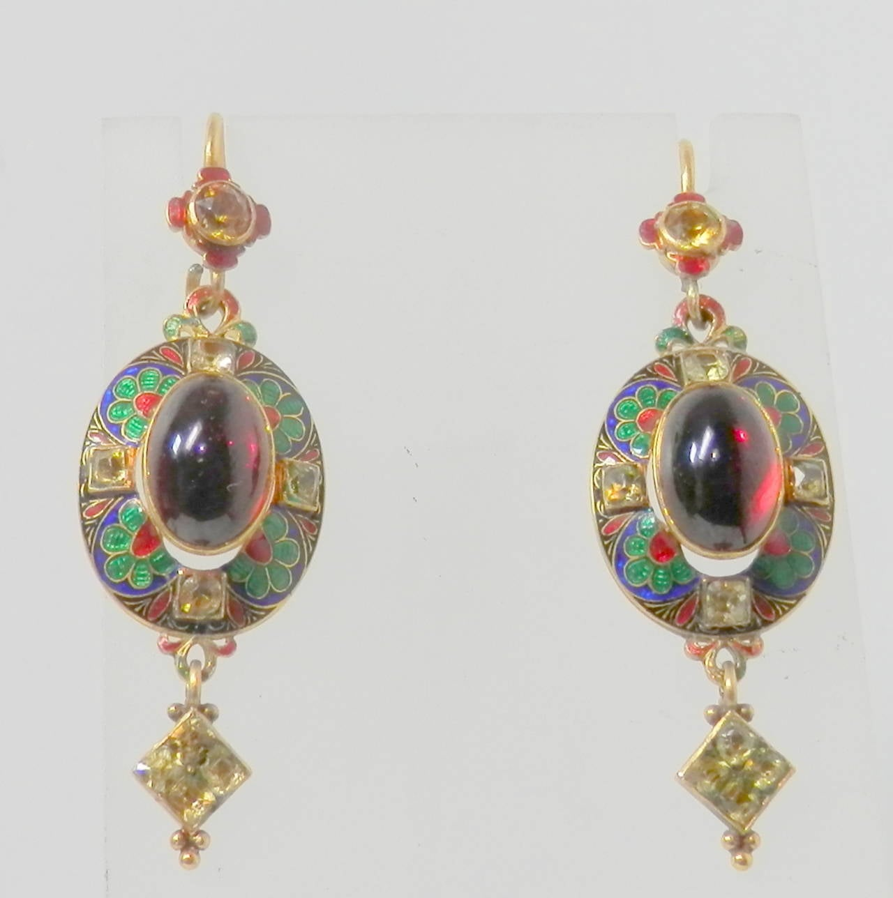 Renaissance revival earrings, circa 1885, with gold, enamel, cabochon garnet and chrysoberyl earrings (the matching pendant is also shown on this site).