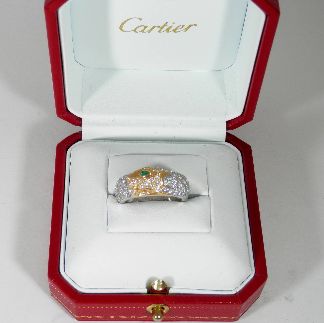 Contemporary Cartier Emerald Diamond Gold Panther Band Ring