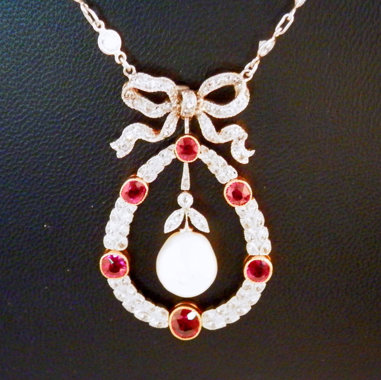 Edwardian Natural Pearl Ruby Diamond Platinum Pendant For Sale 1