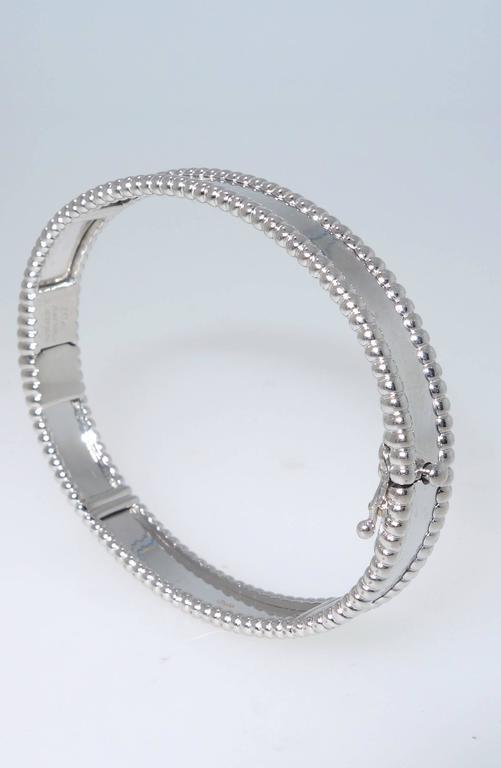 Contemporary Van Cleef & Arpels Iconic Gold Bangle Bracelet For Sale