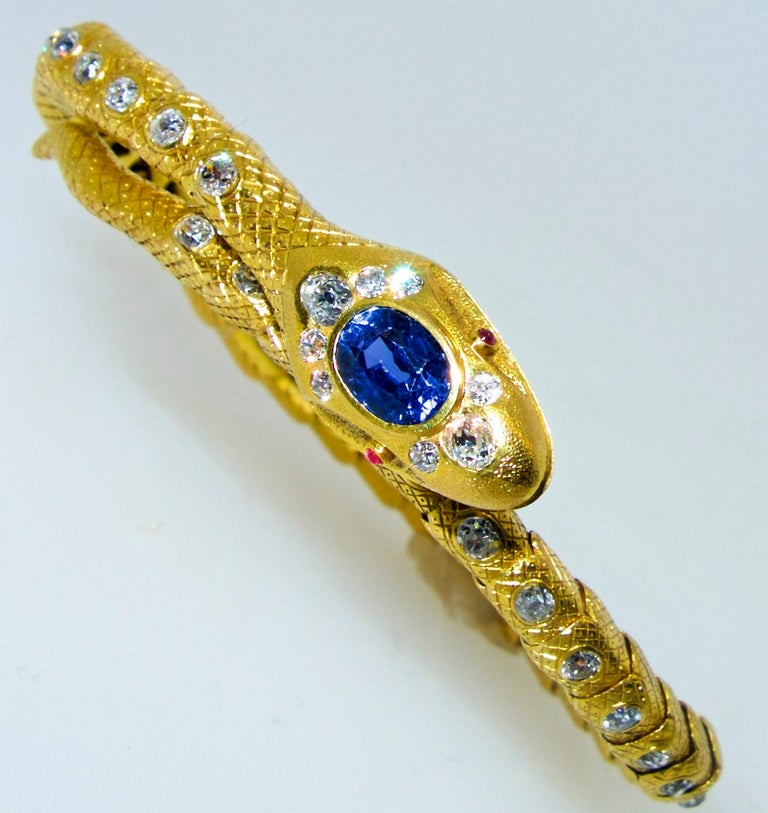 Antique Serpent  bracelet in 18K which will wrap around just about any wrist size.  The sapphire weighs approximately 2 cts. and is an natural unheated Ceylon stone.  There are 46 mine cut diamonds amounting to approximately 3.8 cts.  These old cut