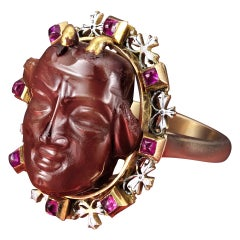 Antique Ring of a Fine Carving Surrounded with Rubies and Enamel