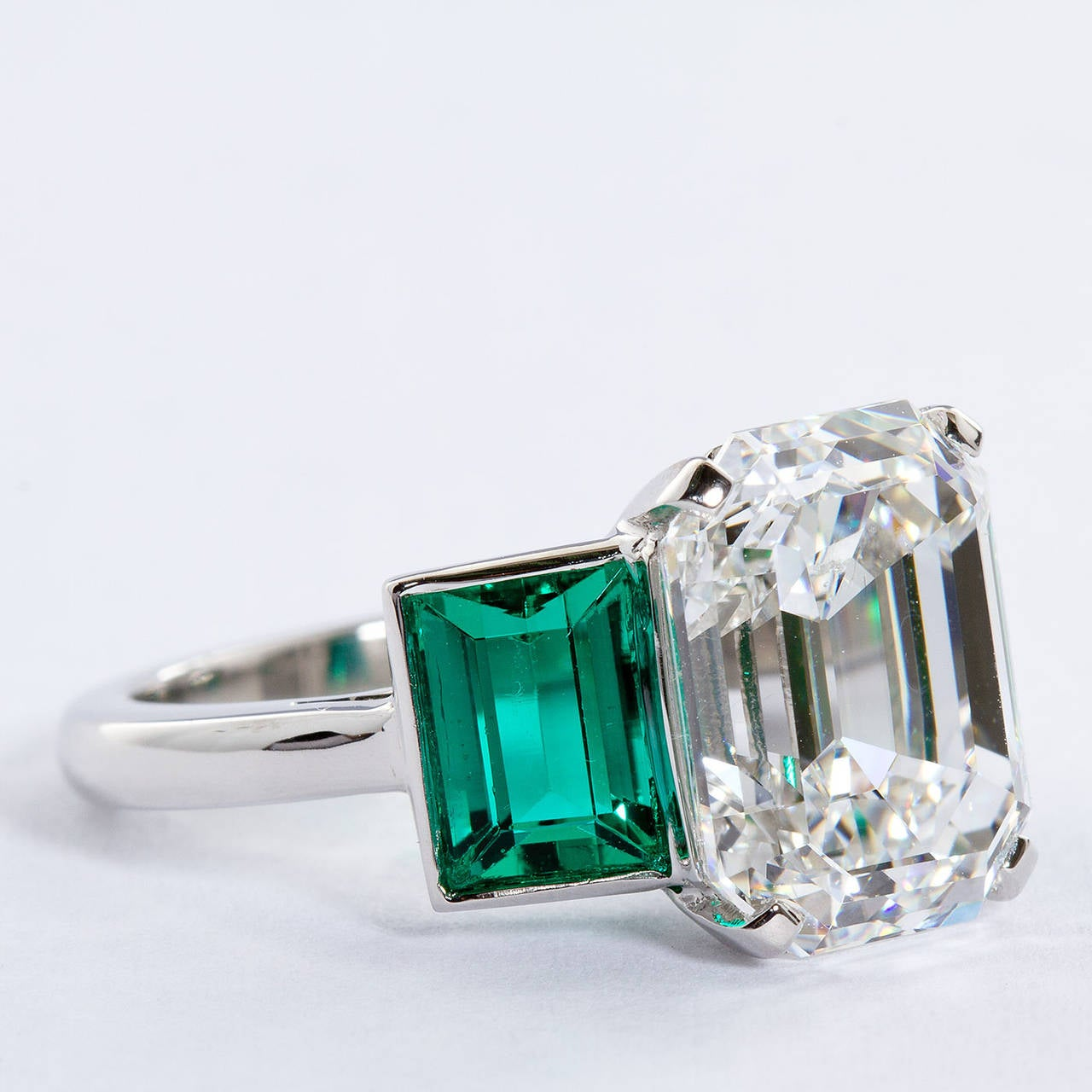 ring side louisette product diamond engagement emerald profile main stones rings with three cut stone
