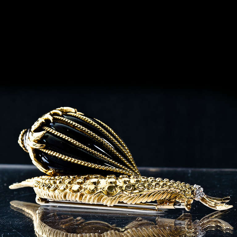 A David Webb original glossy black enamel over 18k yellow gold snail brooch. Measures 2-3/4 x 1-3/8 x 1 inches. Approx 0.12 cts diamond eyes.  Dealer ref No. 5464b _ TMW Jewels Co. is a jewelry boutique in the heart of New York City's jewelry