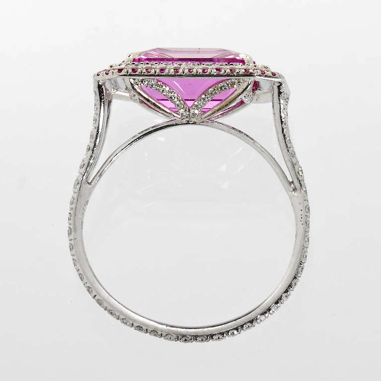 A 4.17 carat octagonal step cut natural no-heat purple-pink sapphire set in a white gold diamond pave with numerous purplish pink round brilliant sapphire border ring. Accompanied by a GIA report.  No. TMWJ-4816 _ TMW Jewels Co. is a family owned