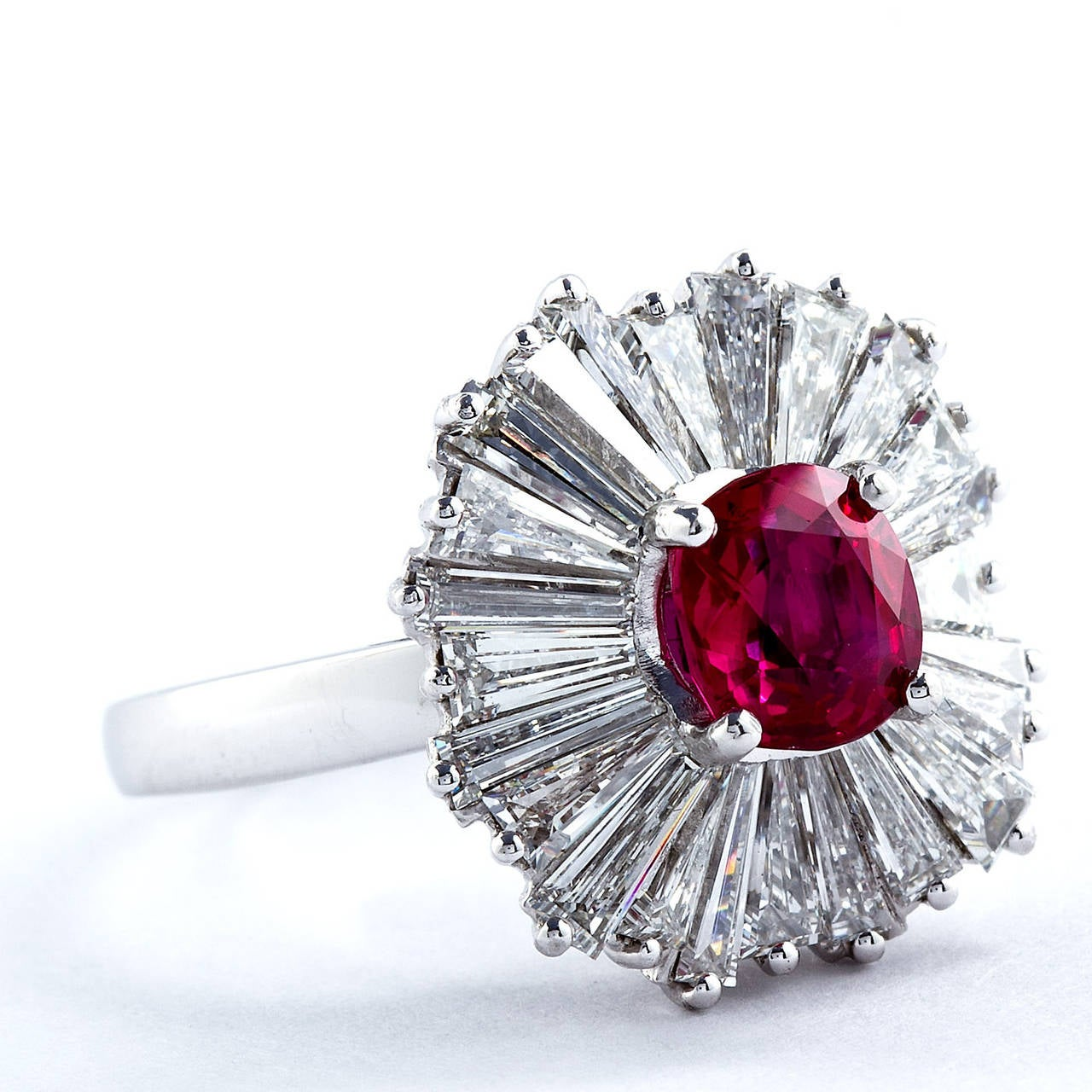 A magnificent 1.86 carat cushion cut Burmese no-heat ruby set in a diamond and platinum tapered baguette ballerina ring. Contains approx. 3.00  carats of high color and clarity diamonds. Exceptional color. With AGL report.  Ring size 7