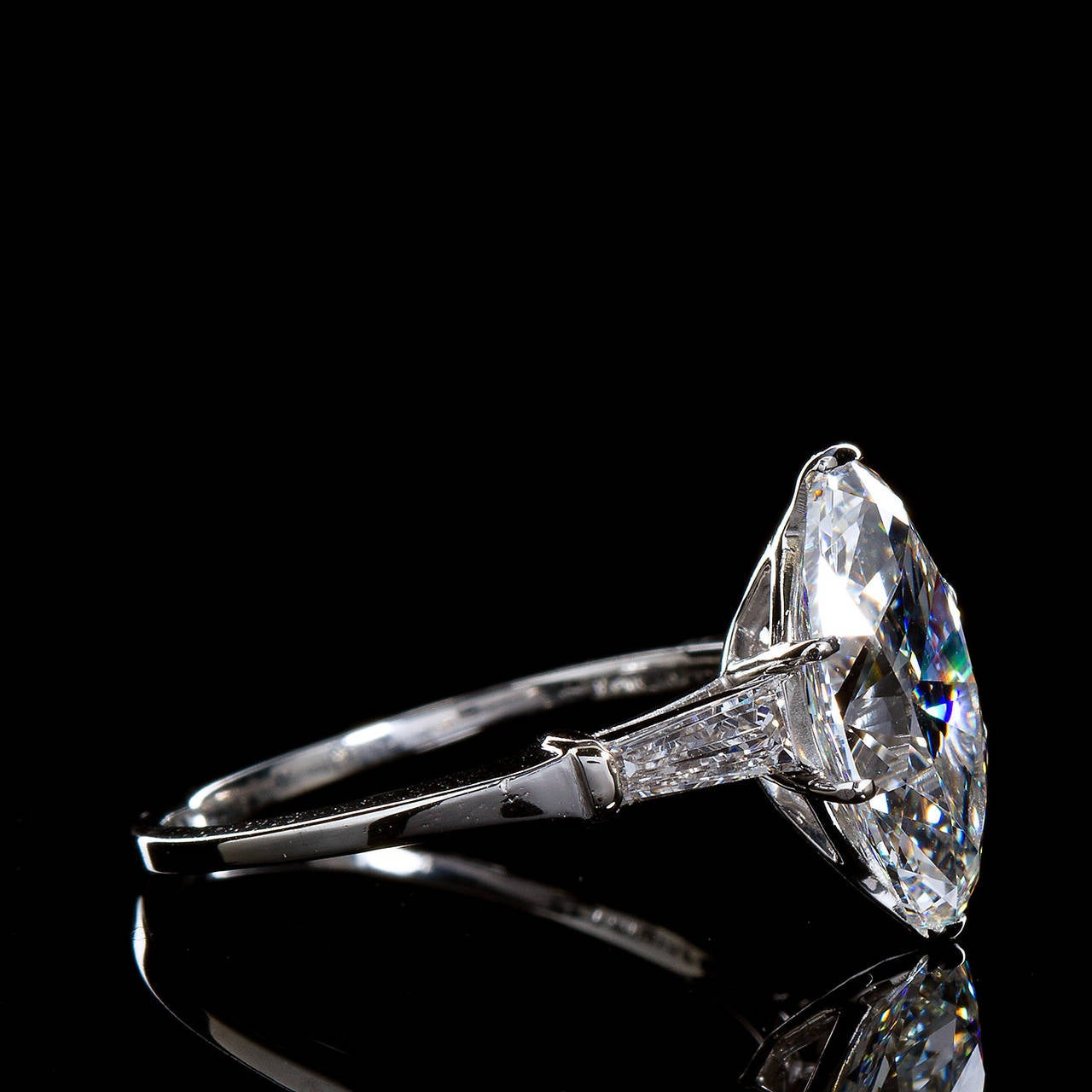 3 Carat Oval Diamond Tapered Baguettes F/VS1 GIA Engagement Ring.  A classic oval shaped diamond with tapered baguette side stones platinum ring. The center stone is a 3.09 carat F color VS1 clarity diamond with an accompanying GIA diamond