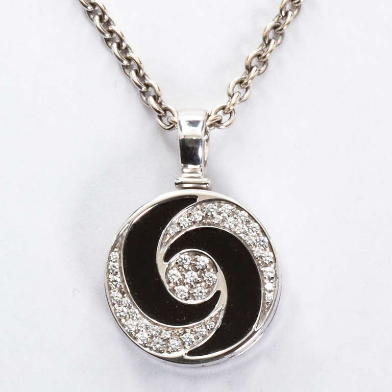 Bulgari spinning diamond gold onyx optical illusion pendant for bulgari spinning diamond gold onyx optical illusion pendant in excellent condition for sale in new york mozeypictures Images