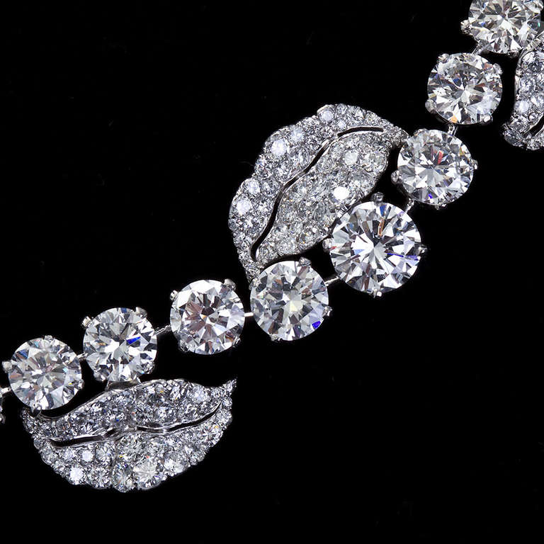 A unique diamond in platinum French garland design necklace with large round brilliant diamonds set Rivieré style within winding diamond pavé petals.  Diamond center stone is a round brilliant 2.01ct D color VS2 clarity, with approx. 52ctw of
