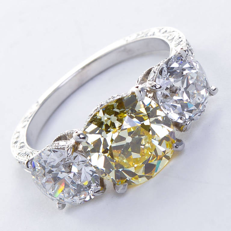 Women's 2.72 Carat Old Mine Fancy Yellow Three-Stone Diamond Ring GIA Certified For Sale