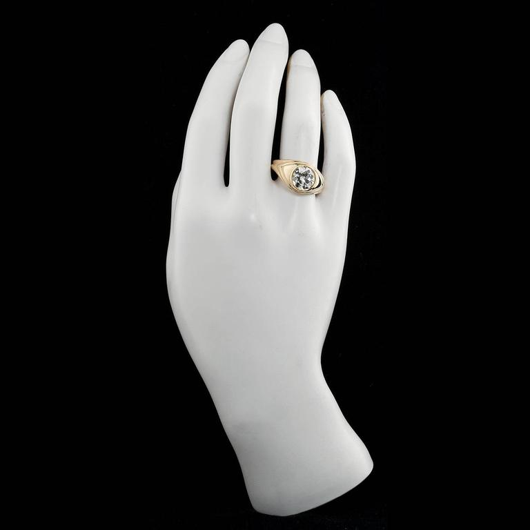 A 2.86 carat I color VS2 clarity Old European cut diamond bezel crimp set in a simple polished yellow gold ring.  Ring size 9-1/2 US. Diamond is graded based on GUA standards to be I color and VS2 clarity.  No. 7294-7197