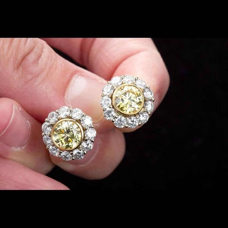 Fancy Yellow GIA Diamond Halo Cluster Earrings Studs In As new Condition For Sale In New York, NY