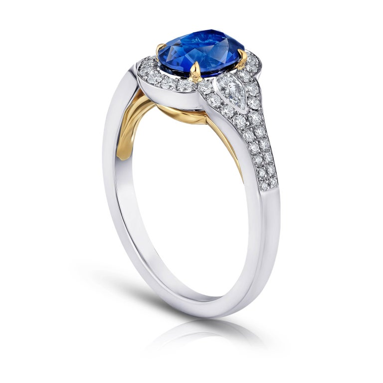 1 63 Carat Oval Blue Sapphire and Diamond Ring For Sale at 1stdibs
