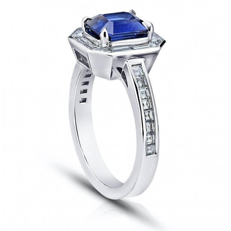 A fine blue sapphire and diamond set in platinum ring.  Center stone is a 2.55 carat blue emerald cut sapphire carefully prong set in a magnificent border of calibrated twelve baguette cut diamonds forming an octagon.  The ring shoulders are set
