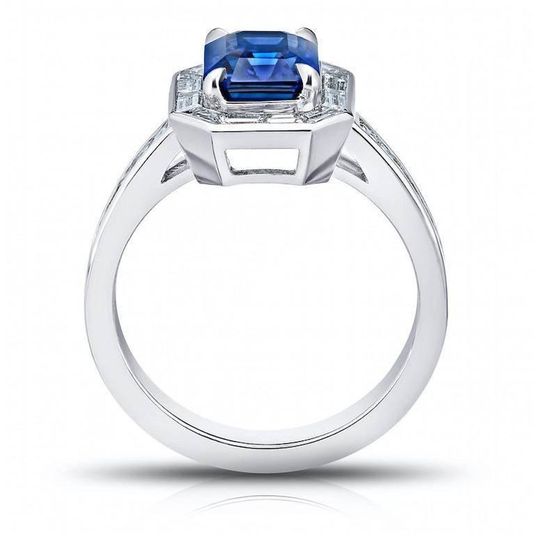 2.55 Carat Emerald Cut Blue Sapphire Baguette Diamond Halo Ring In New Condition For Sale In New York, NY