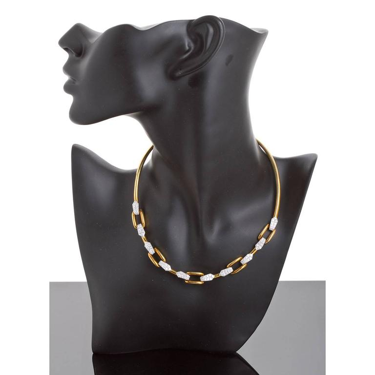 A fine 18 karat gold necklace with diamond pavé accents by David Webb Circa 1985. The necklace is approximately 15 inches long. When closed it has an inner diameter of 4 1/2 inches. Signed WEBB.  No. 2073