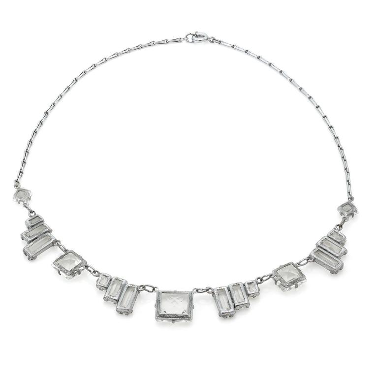 This exquisite Art Deco necklace is austere and modern. The glamorous angles create a unique look that is both classic and exciting. The quartz crystals are faceted and reflect light in beautiful colors and the sterling silver chain links are bold.