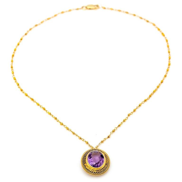 Amethyst Oval Set in 14 Karat Gold Filigree Necklace
