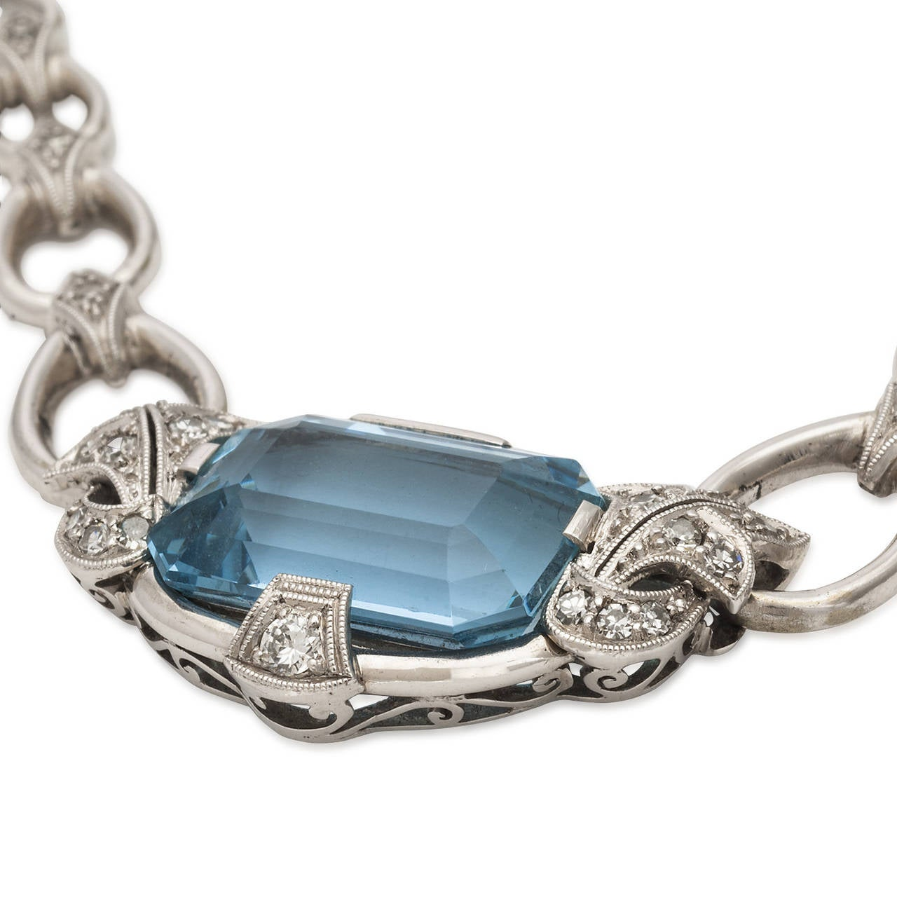 The aquamarine 5.5ct TW in this necklace has a brilliant blue color and clarity that is unusual to find in such a large stone. The color is accentuated by the 23 diamonds TW of 0.2ct set in 18k white gold. The style is definitely 1960's