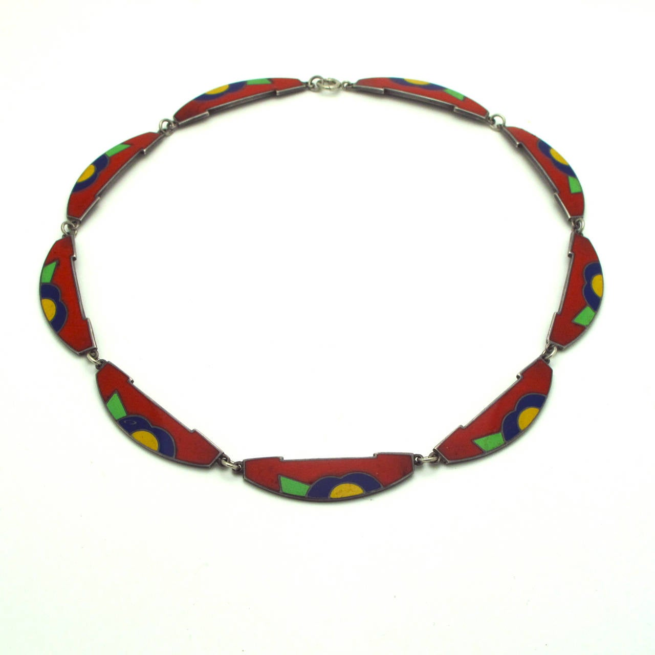This enamel inlay and scallop necklace in red, blue, yellow and green enamel is vibrant and stunning to the eye. Set on a background of sterling silver with a beautiful patina to bring out the whimsical combination of colors that rests beautifully
