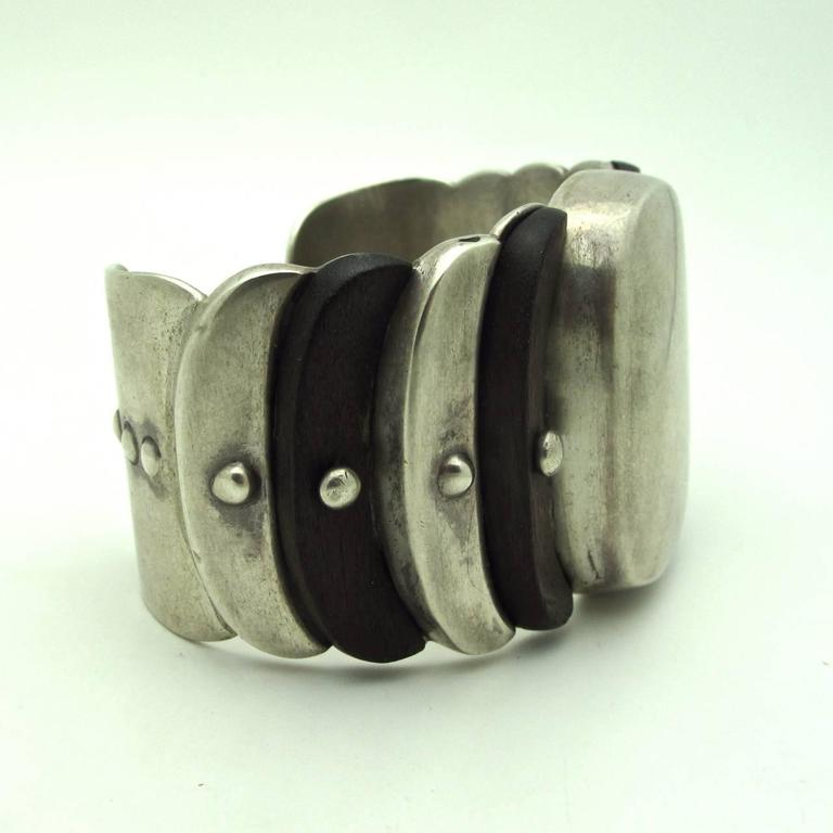 This stunning William Spratling cuff is a majestic combination of rosewood wood and sterling silver. The layers give it a dimension characteristic of his work. Always collectible and timeless.