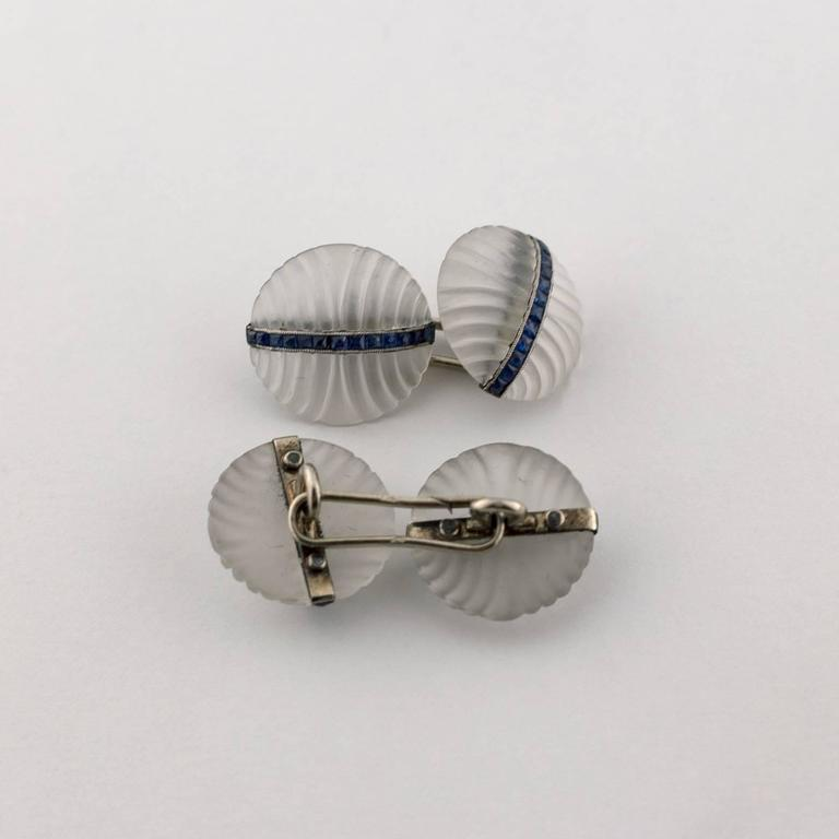 Gifts for him! These cufflinks from the 1920's are stunning with a band of blue sapphires set in 18k white gold. Stunning simplicity... these cufflinks would be a wonderful gift for a man or a woman. They are French made, mark.