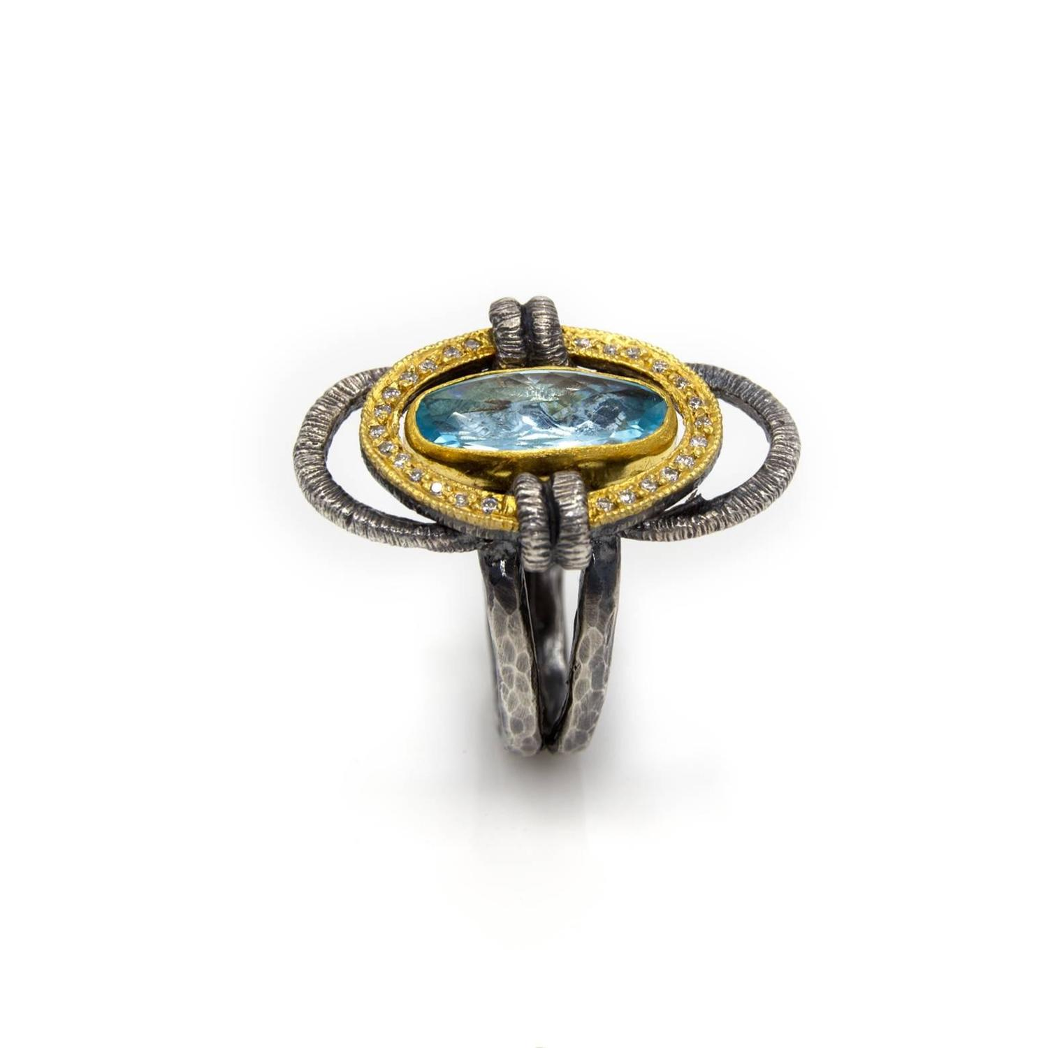 blue topaz and ring in oxidized silver and gold at
