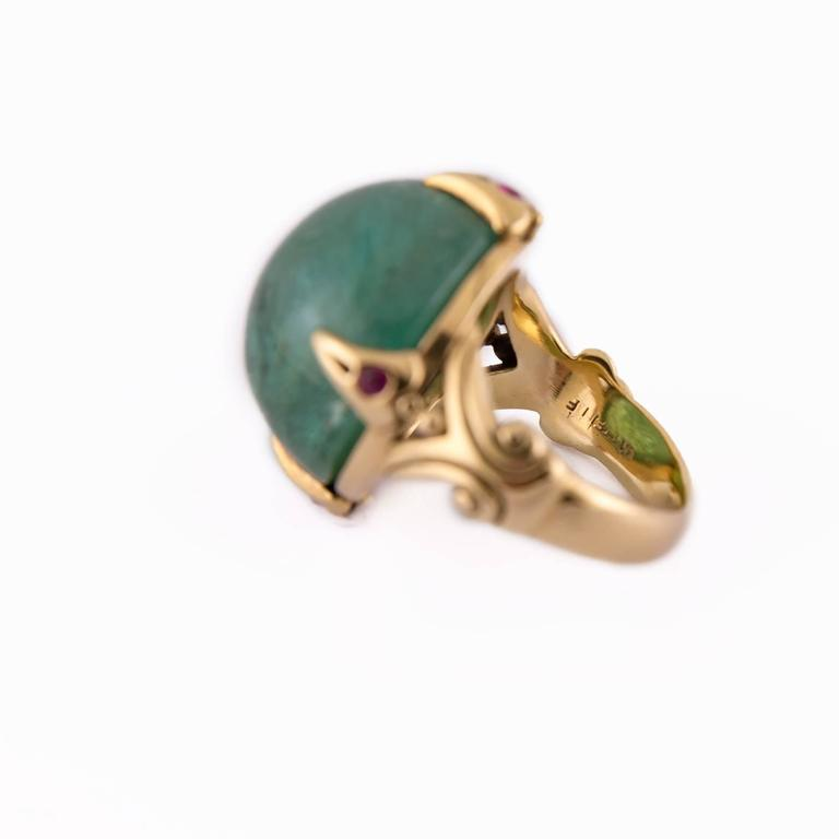 Medieval 39.50 Carat Round Green Tourmaline Ring with Round Accent Rubies in Gold For Sale