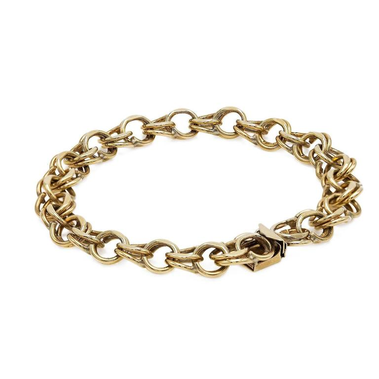 Classic and Chic 14K Yellow Gold Chain Link Bracelet. A must have for any sophisticated jewelry collection. With a substantial weight and an elegant design this bracelet is gorgeous.