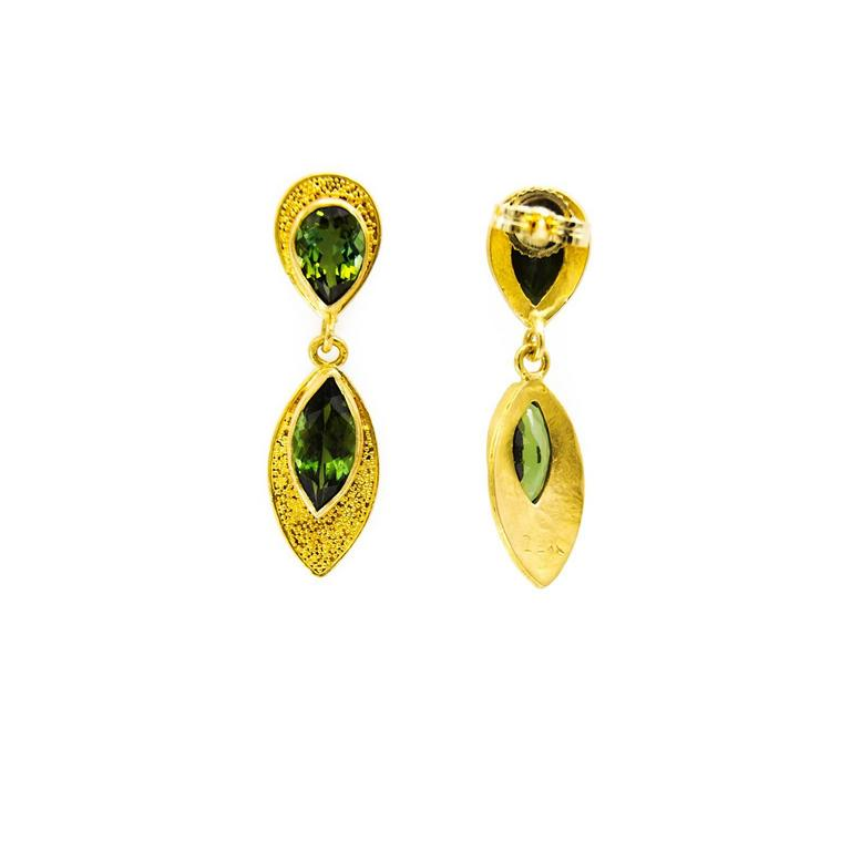 Pear and marquise shaped olive green tourmalines adorned in textured 18K yellow gold. Elegant and rich in color the gold shines bright against the deep green and together they create a masterpiece.