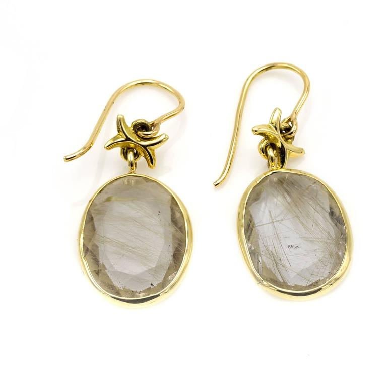 Quartz With Gold Inclusions : Clear quartz crystal with golden rutile inclusions gold