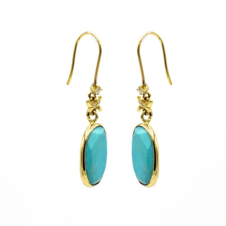 These stunning bright turquoise earrings are wonderfully faceted with seven accent diamonds on each earring. One large diamond on top and six set in the beautiful golden design. Sparkly and decorative these earrings add elegance to brighten up any