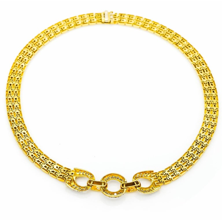 Elegant and stunning this thick chain link necklace is complimented by the delicate white gold pave diamond circles. A substantial piece that's vintage and in style. Comfortable and glamorous!