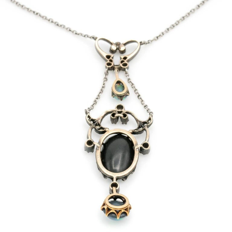 """Antique from the 1880's this Edwardian multi-chain pendant """"pendentif"""" necklace has one original tear drop opal and two oval opal doublets that glow with brilliant blues and greens. A beautiful and detailed necklace with celestial diamonds"""