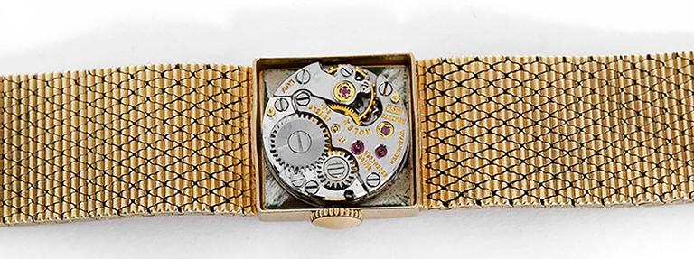 Manual winding. 14k yellow gold case (15mm x 15mm). Silvered dial with stick markers. 14k yellow gold integrated mesh bracelet with Rolex crown on clasp (will fit apx. 5-1/2 in. wrist). Pre-owned with custom box.