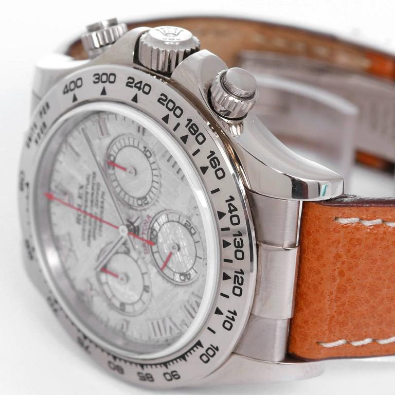 Rolex Cosmograph Daytona Men's White Gold Watch Meteorite Dial 116519 -  Automatic winding, chronograph, 44 jewels, sapphire crystal. 18k white gold case and bezel (40mm diameter). Meteorite dial with Roman numerals. Brown strap with Rolex 18k white