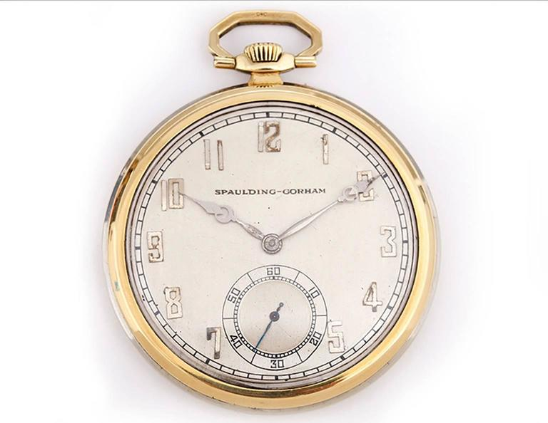 Longines Pocket Watch for Spaulding & Gorham -  Manual winding. Art Deco style 2-Tone 18k white & yellow gold 12 size (45mm diameter). The case back as well as the 14k gold case of the pocket watch are both engraved with the initials WJH. Silver