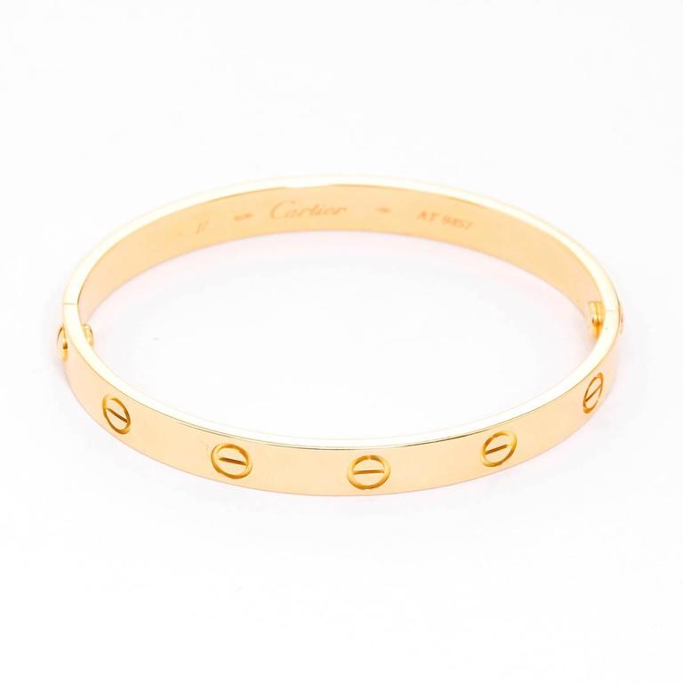 Cartier Love Bracelet 18k Yellow Gold Size 17 with Screwdriver - . This beautiful bracelet is stamped Cartier, 18, 750  and AT9457.  This is a great piece for everyday as well as dress. Authenticity guaranteed. Like new condition with no dings or