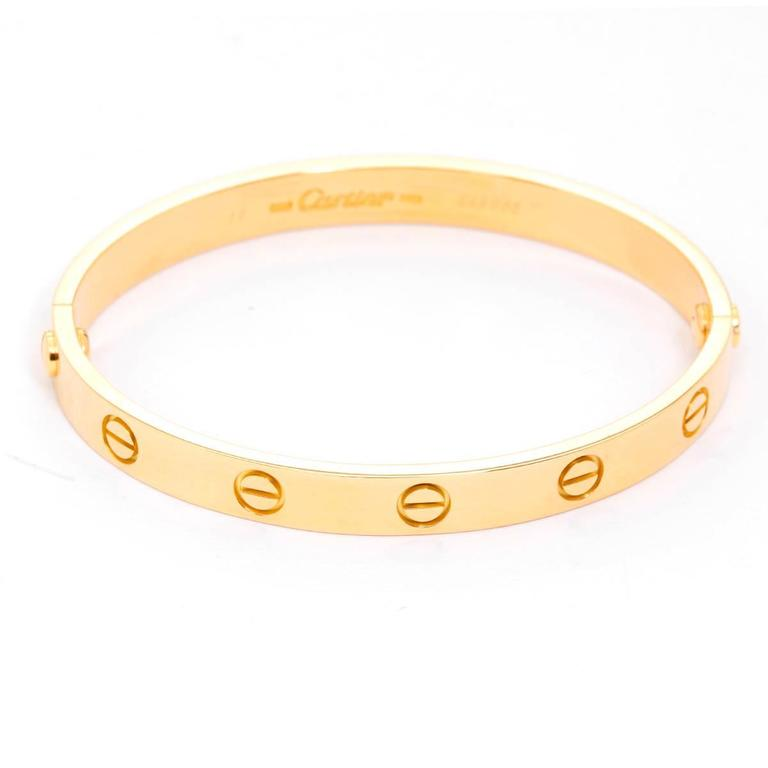 Cartier Love Bracelet 18k Yellow Gold Size 16 with Screwdriver - . This beautiful bracelet is stamped Cartier, 16, 750  and E48985.  This is a great piece for everyday as well as dress. Authenticity guaranteed. Like new condition with no dings or