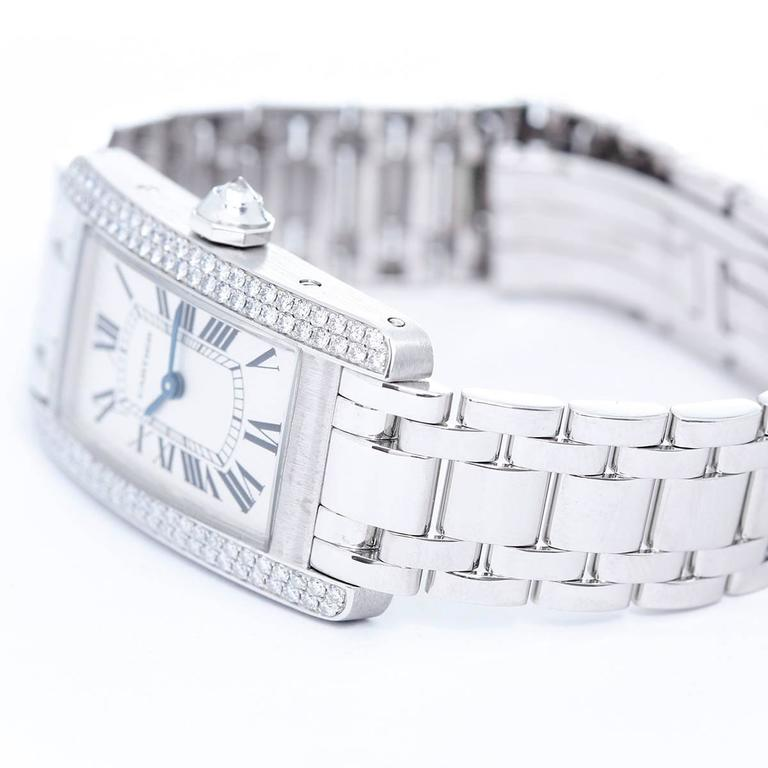 Cartier Tank Americaine (or American) Ladies WG Diamond Watch WB7018L1 -  Quartz movement. 18k white gold case with 2-row factory diamond bezel  (19 mm x 35 mm ) (19mm x 40mm). Silver colored with black Roman numerals. 18k white gold Cartier
