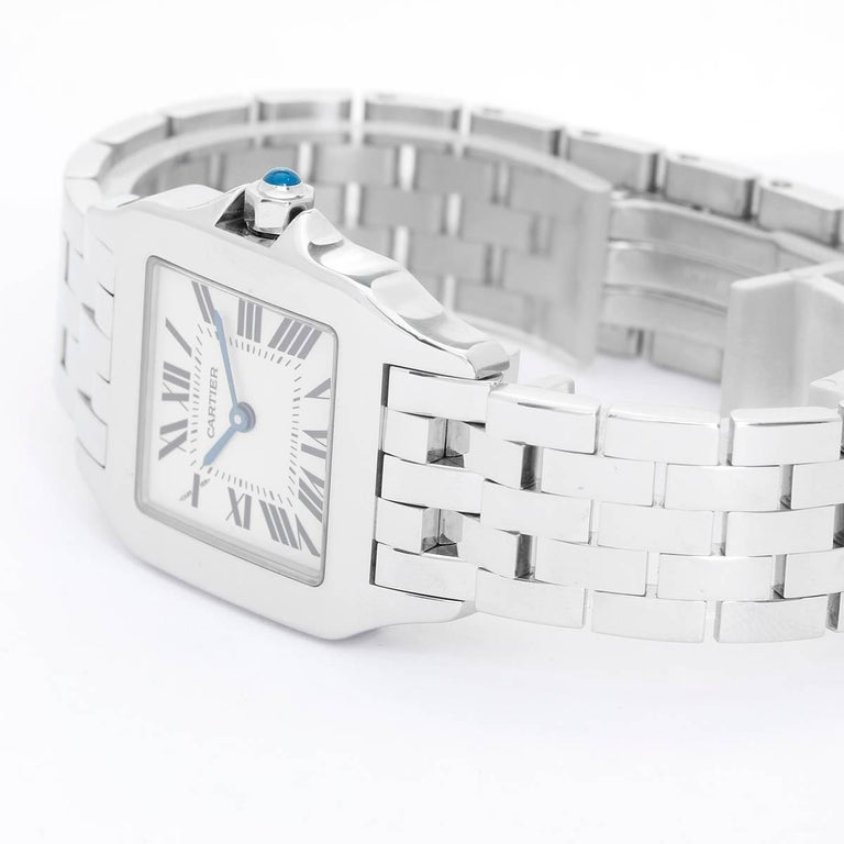 Cartier Santos Demoiselle Midsize Ladies Watch -  Quartz. Stainless Steel  (26mm). Ivory dial with Roman numerals. Stainless Steel  Cartier Bracelet with Deployant Buckle. Pre-owned with custom box.