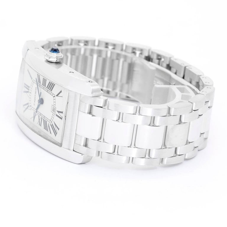 Cartier Tank Americaine 18K White Gold W26055L1 -  Automatic winding. 18K White Gold ( 26 x 44 mm ). Silvered guilloche dial with black Roman numerals; Date at 6:00 o' clock. 18K White Gold Cartier bracelet with deployant clasp. Pre-owned with