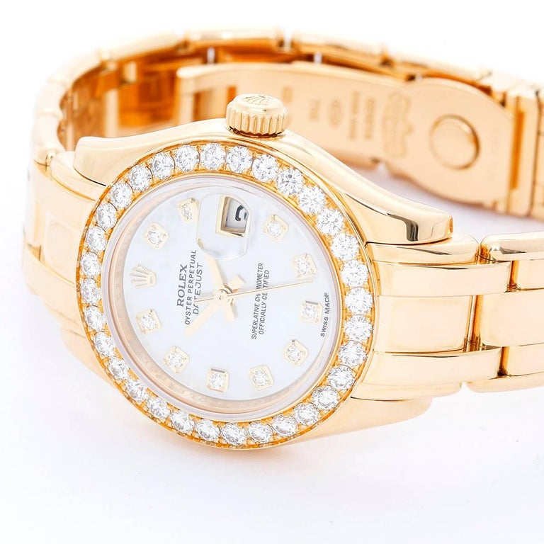 Rolex Ladies Masterpiece/Pearlmaster 18k Gold Diamond Watch  80298 -  Automatic winding, 31 jewels, Quickset, sapphire crystal. 18k yellow gold case with full factory diamond bezel (27mm diameter). Factory Mother Of Pearl diamond dial. 18k yellow
