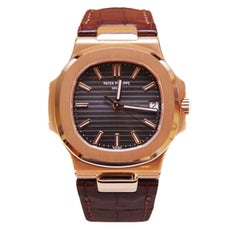 Patek Philippe & Co. Nautilus Men's 18 Karat Rose Gold Watch 5711R-001