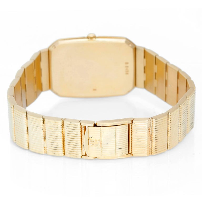 Audemars Piguet Yellow Gold Black dial Vintage Manual Wristwatch In Excellent Condition For Sale In Dallas, TX