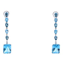 18 Karat White Gold Blue Topaz Dangling Earrings