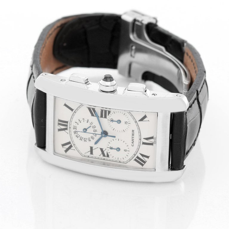 Cartier Tank Americaine (or American) Chronograph Men's Watch W2603356 -  Quartz chronograph with date. 18k white gold rectangular style case (26mm x 45mm). Ivory colored dial with black Roman numerals; date; hour minutes and seconds recorders.