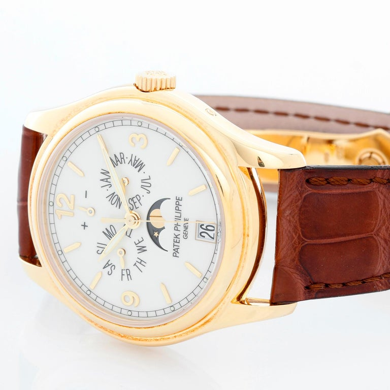 Patek Philippe Annual Calendar Yellow Gold Men's Moonphase Watch 5146J (5146 J) - Automatic winding; day, date, month and moonphase. 18k yellow gold case with exposition back to view movement (39mm diameter). Cream colored dial with gold Arabic